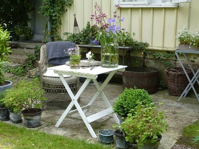 Arrange A Table And Chairs Set At The One Corner Of Your Garden. This Is  Also A Good Tip For Decorating Your Outdoor Area. You Can Have Tea In  Evening And ...